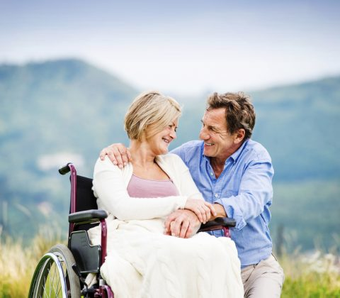 Man with woman in wheelchair psoriatic arthritis