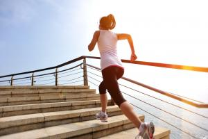 healthy-lifestyle-woman-legs-running-on-stone-stai-39906607 ankylosing-spondylitis